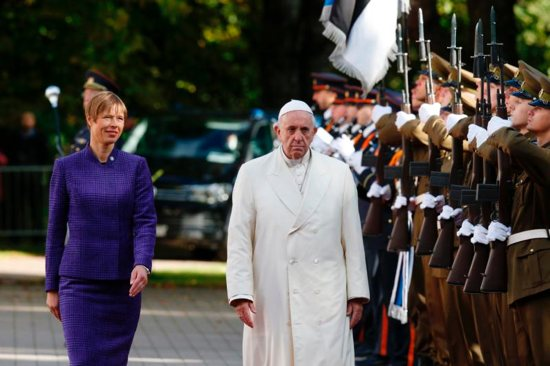 Pope Francis and Estonian President Kersti Kaljulaid attend a welcoming ceremony at the presidential palace in Tallinn, Estonia