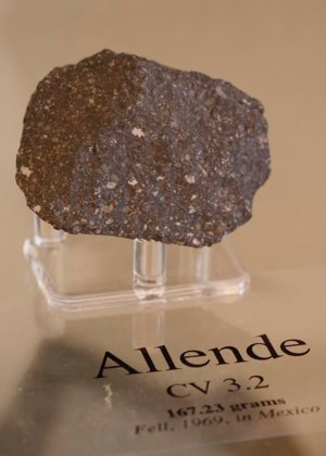 A piece of a meteorite that fell on a car in Peekskill, N.Y., in 1992 is displayed in 2009 at the headquarters of the Vatican Observatory in Albano, Italy.