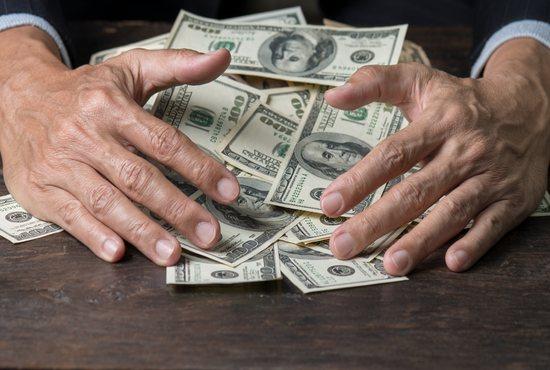Greedy hoarding of wealth