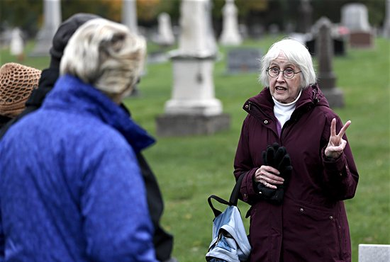 Mary-Benton Hummel, a St. Paul Community Education instructor, gives a tour of Calvary Cemetery in St. Paul
