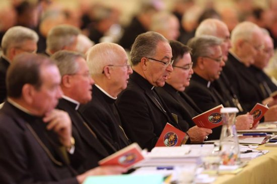 Prelates pray during the 2017 fall general assembly of the U.S. Conference of Catholic Bishops in Baltimore. Discussion and voting on concrete measures to address the abuse crisis and a day of spiritual discernment and prayer will top the agenda for the U.S. bishops when they meet Nov. 12-14 in Baltimore.