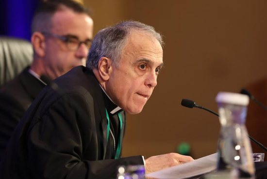 Cardinal Daniel N. DiNardo of Galveston-Houston, president of the U.S. Conference of Catholic Bishops, listens to a question Nov. 12 during the fall general assembly of the USCCB in Baltimore. Also pictured is Msgr. J. Brian Bransfield, general secretary.