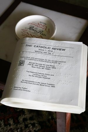Catholic materials in Braille are seen in early May at the residence of Cuban-American Adelina Maideski, a former gift store employee at Miami International Airport, who attends St. Martha Church in Miami Shores.