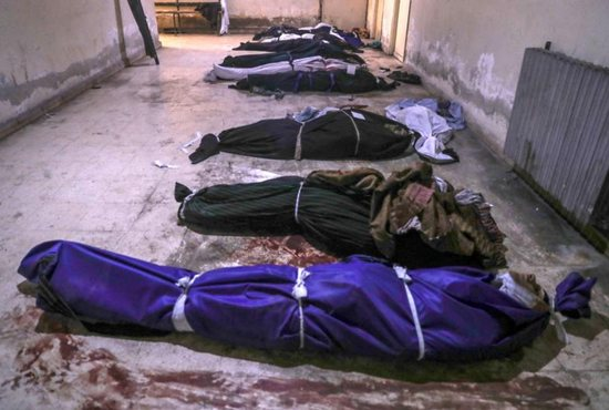 "Bodies of people allegedly killed by Islamic State militants are seen on the floor of a morgue in late February in Douma, Syria. The U.S. House Nov. 27 passed a measure to provide humanitarian relief to victims of genocide in Iraq and Syria and hold IS ""accountable."""
