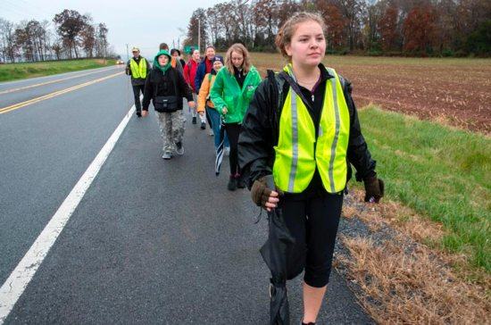 "Monica Rubeling, 16, of St. Peter the Apostle in Libertytown, Md., walks the ""Fifty Miles in Faith: Pilgrimage-Walk for the Priesthood in Penance and Prayer"" Nov. 9. Her brothers include two studying for the priesthood and Father Michael Rubeling, associate pastor of St. John the Evangelist in Severna Park, Md."