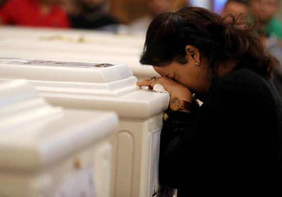 A woman mourns during a Nov. 3 funeral Mass at Prince Tadros Orthodox Church in Minya, Egypt, for a group of Christian pilgrims killed by gunmen as they headed to a monastery