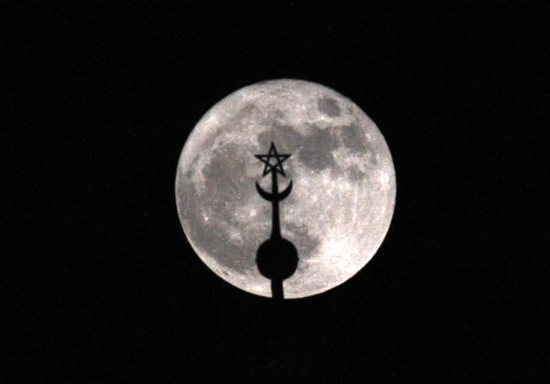 In this 2016 file photo, a super moon rises above the roof of the Mohammed V mausoleum in Rabat, Morocco. Pope Francis is scheduled to visit the North African nation in March 2019.