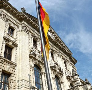 The German flag is seen outside the Ministry of Justice in Munich. German police and prosecutors are launching investigations into clergy sexual abuse following the Sept. 12 leak of a report containing evidence of 3,700 alleged child sex abuse cases in the Catholic Church over a 68-year-period.