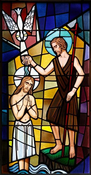 Christ's baptism by John the Baptist at the Jordan River is depicted in a stained-glass window at St. Francis of Assisi Church in Greenlawn, N.Y.