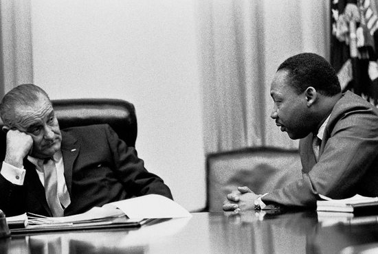 Civil rights leader the Rev. Martin Luther King Jr. talks with U.S. President Lyndon B. Johnson in this undated photo. Johnson signed the Civil Rights Act into law July 2, 1964. Martin Luther King Jr. Day is celebrated Jan. 21 this year.