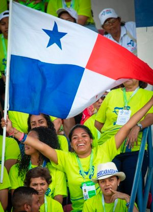 A World Youth Day volunteer waves her Panamanian flag as she cheers for Pope Francis at Panama City's Rommel Fernandez Stadium Jan. 27, 2019. Pope Francis thanked volunteers for making World Youth Day a reality.