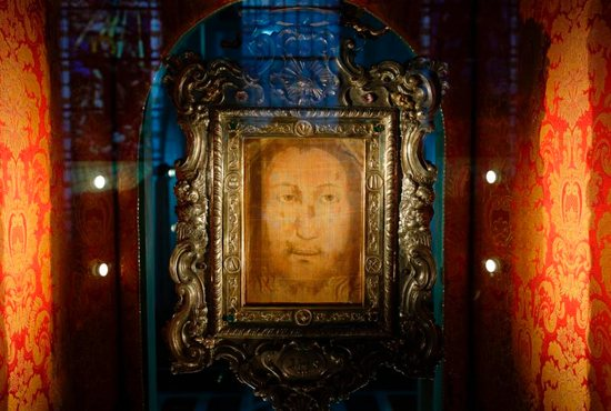 The Holy Face of Manoppello is pictured on display at the shrine in Manoppello, Italy, Jan. 11. Devotees believe that the almost transparent cloth was one of the burial shrouds that covered the face of Jesus in the tomb and that the image was formed miraculously at the moment of the resurrection.