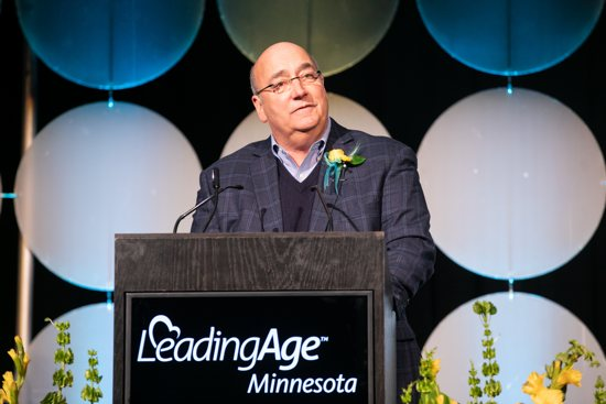 Bill Foussard, a member of the board of Cerenity Senior Care in St. Paul, accepts the Board Trustee of the Year award Feb. 6 from LeadingAge Minnesota at a ceremony at the  St. Paul RiverCenter in St. Paul.