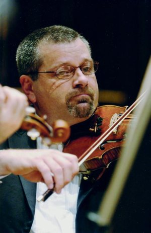 In this undated photo, David Bartolowits performs with the Indianapolis Symphony Orchestra. He played with the orchestra for 35 years then became the director of catechesis at St. John the Evangelist Parish in 2017 and was ordained a deacon for the Indianapolis Archdiocese that same year.