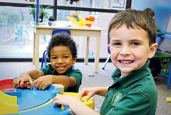 "Nolan Pergolski, foreground, and Luke Owusu-Afriyie play cars during ""free choice time"" Sept. 20 in the preschool classroom at St. Joseph School in Rosemount."