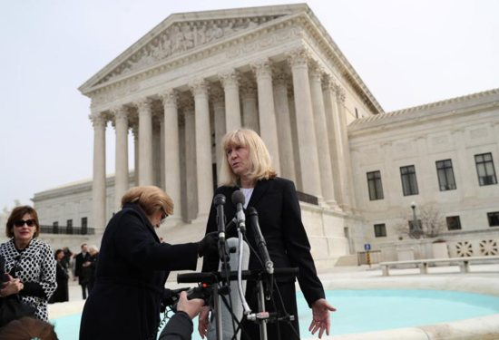 Sheri Lynn Johnson of the Cornell University Death Penalty Project, who represents death-row inmate Curtis Flowers, speaks to the news media outside the U.S. Supreme Court in Washington March 20, 2019. In mid-March, the Supreme Court considered possible racially biased juries in two death penalty cases, which included Flowers.