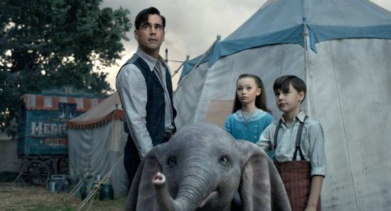 """Colin Farrell, Nico Parker and Finley Hobbins star in a scene from the movie """"Dumbo."""" The Catholic News Service classification is A-II -- adults and adolescents. The Motion Picture Association of America rating is PG -- parental guidance suggested. Some material may not be suitable for children."""