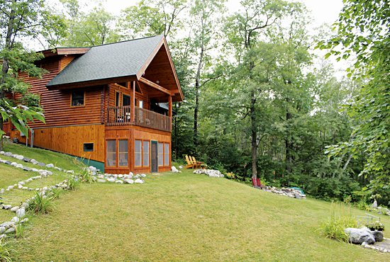 The St. Francis Lodge retreat house includes a large house and an upper floor of a garage that can sleep up to eight people along Lake George, near Itasca State Park