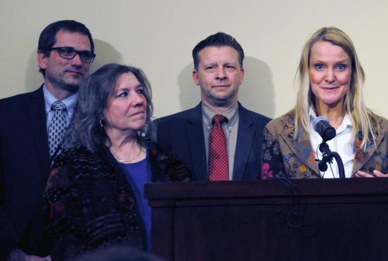 Moana Patterson, at left, a teacher at Valley View Elementary in Bountiful, Utah, appears at a March 11, 2019, news conference, where she told reporters she never would have asked her student, William McLeod, to wash off the ashes on his forehead if she had known they were a sacred religious symbol. She is pictured with two members of the Utah Legislature, Republican Rep. Ray Ward and Republican Sen. Todd Weiler, and Tiffany Ivins-Spence, the mother of a student in Patterson's class.