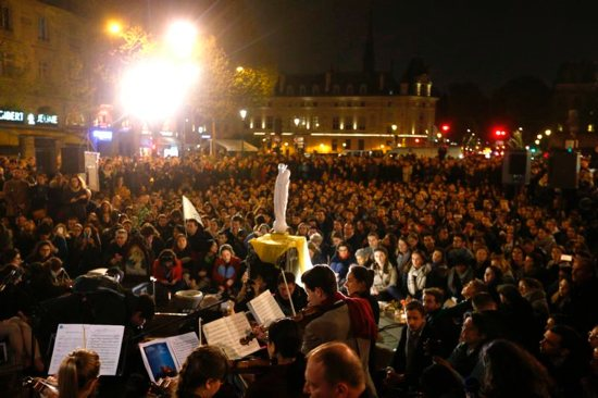 People attend a vigil outside Notre Dame Cathedral April 16, 2019, a day after a fire destroyed much of the church's wooden structure. Officials were investigating the cause of the blaze, but suspected it was linked to renovation work that started in January.