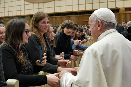 Pope Francis greets people during an audience with students and staff from Ennio Quirino Visconti Lyceum-Gymnasium, a school in Rome, at the Vatican April 13, 2019. The pope encouraged high school students to break their phone addiction and spend more time on real communication and moments of personal reflection.