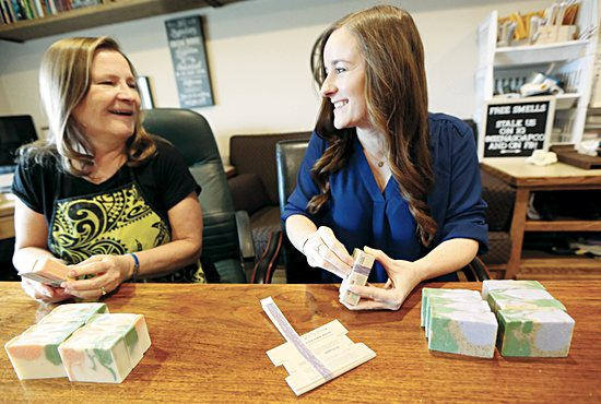 From left, Mary and Jessica Ottman package finished soap bars April 9 in the lower level of Mary's home in Blaine, where they have set up Siena Soap Company operations. Siena Soap is offering readers of The Catholic Spirit free shipping at sienasoap.com; use the free shipping code Siena.
