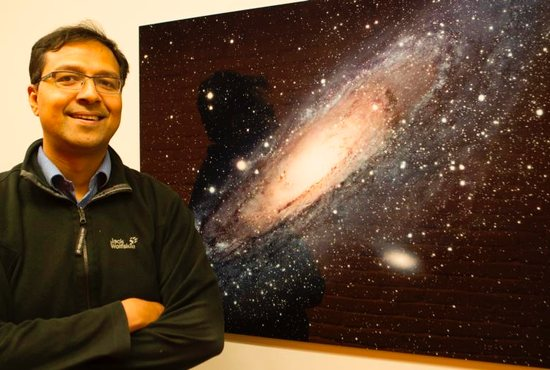 Jesuit Father Richard D'Souza, pictured in a May 8, 2019, photo, in Ann Arbor, Mich., studies the structure of stellar halos around galaxies. An astronomer on the Vatican Observatory staff, Father D'Souza is completing three years of post-doctoral research at the University of Michigan.