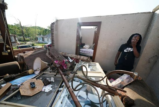 Armonn Cody stands in his destroyed home May 23, 2019, following a tornado in Jefferson City, Mo. An outbreak of strong storms the evening of May 22 spawned tornadoes that razed homes, flattened trees and tossed cars across a dealership lot, injuring about two dozen people in Missouri's capital city and killing at least three others elsewhere in the state.
