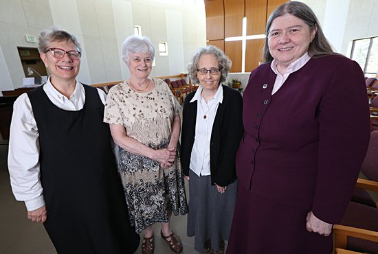 Sister Catherine Nehotte, right, stands with other members of the leadership team in the chapel at St. Paul's Monastery in Maplewood: Sisters Linda Soler, left, Mary White and Jacqueline Leiter.