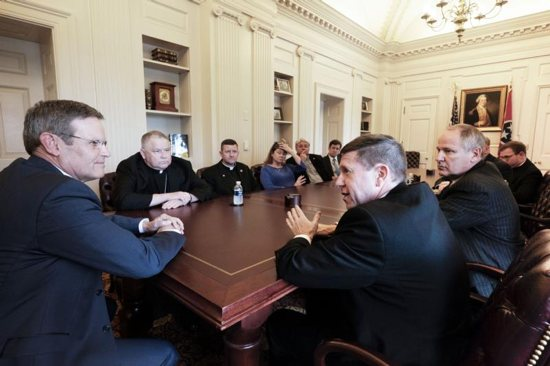 Bishop J. Mark Spalding of Nashville, Tenn., joined by Brian Cooper, Chief Administrative Officer and Vice Chancellor of the Diocese of Nashville, right, talks with Tennessee Gov. Bill Lee in his office at the Tennessee State Capitol in Nashville April 23, 2019, as Bishop Richard Stika and members of the Diocese of Knoxville look on. The bishops discussed the education savings account bill, which was passed by both the House of Representatives and Senate on Wednesday, May 1, as well as abortion legislation and pending executions in the state.