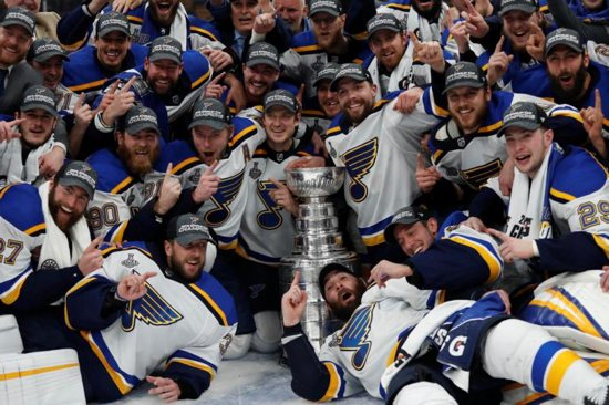 St. Louis Blues players pose for a team photo with the Stanley Cup after defeating the Boston Bruins in Game 7 of the 2019 Stanley Cup Final in Boston June 12, 2019. It was their first Stanley Cup in team history.