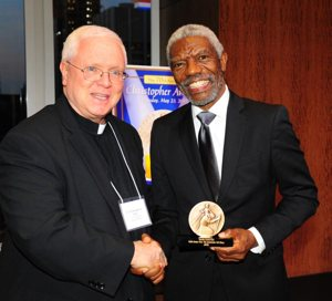 Father Edward M. Dougherty of The Christophers board of directors poses with actor-director Vondie Curtis-Hall after he received The Christopher Award