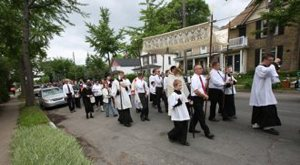 A eucharistic procession winds through the neighborhoods of Northeast Minneapolis