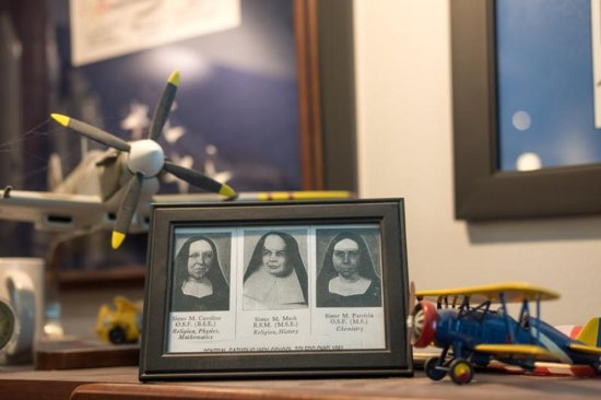 Framed portraits sit on the desk of Gene Kranz, former NASA flight director, May 17, 2019. They are of three Ursuline sisters who taught Kranz at Central Catholic High School in Toledo, Ohio.