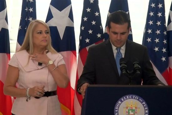 Puerto Rico's Secretary of Justice Wanda Vazquez stands next to Gov. Ricardo Rossello during a news conference in an undated still image from file video in San Juan, Puerto Rico.