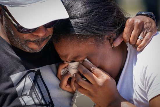A woman weeps during a vigil in Dayton, Ohio