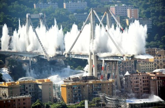 Controlled explosions demolish two of the pylons of the Morandi bridge in Genoa, Italy