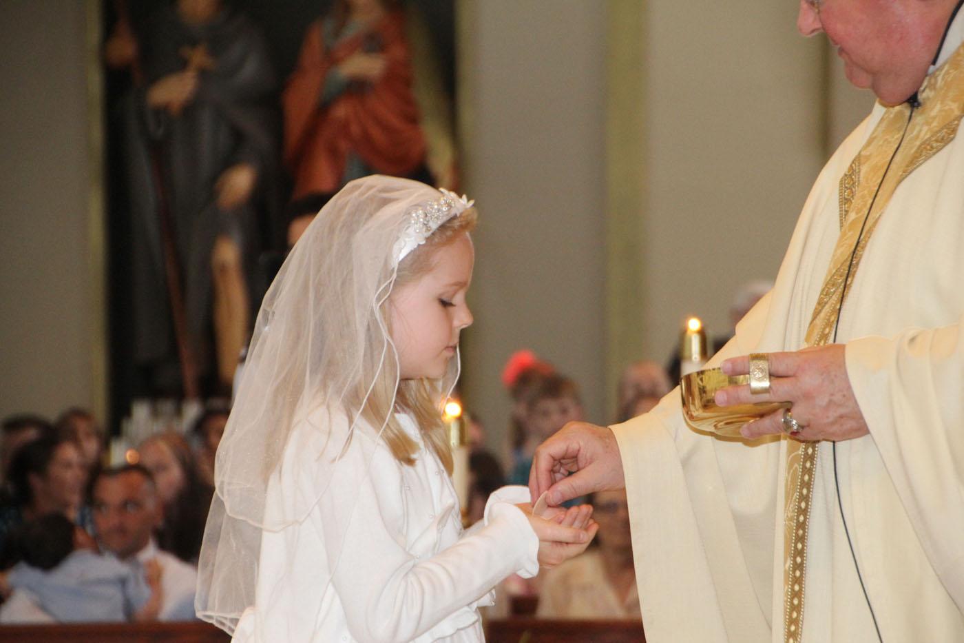 Milestone Of Faith Children Receive First Holy Communion