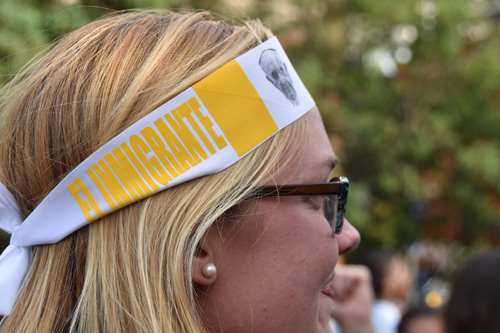 A young woman listens to Pope Francis' speech at Independence Mall Sept. 26. (Sun photo | Katherine Long)