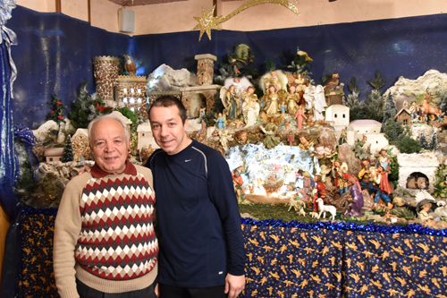 Anthony and Bobby Angotti stand in front of the Nativity scene at Angotti's Family Restaurant in Syracuse. (Sun photo | Katherine Long)