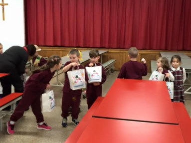 "Students at St. Rose of Lima School in North Syracuse made ""blizzard bags,"" emergency food packages, for Meals on Wheels."