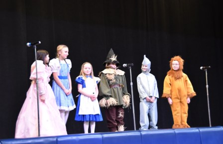 "Members of Blessed Sacrament School's cast of ""Dorothy in Wonderland"" sings ""Will We Ever See Home Again?"""