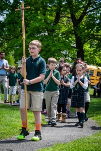 Students from All Saints School processing Thursday to the Marian Shrine at St. Joseph Church in Endicott to recite the rosary and crown the Blessed Mother with flowers.  -Sun photos | Chuck Haupt