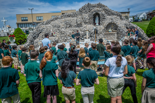 Students from All Saints School in Endicott pray at the Marian Shrine at St. Joseph Church May 12, reciting the rosary and crowning the Blessed Mother with flowers. (Sun photo | Chuck Haupt)