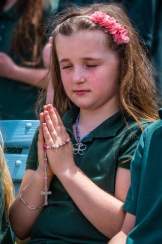 Second grader Breanne Eldred, 8, of All Saints School in Endicott, prays at the Marian Shrine at St. Joseph Church May 12. (Sun photo | Chuck Haupt)