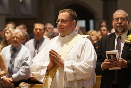 Father Peter Tassini, as his ordination Mass begins. (Sun photo | Chuck Wainwright)