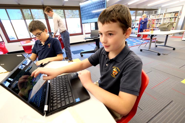 Holy Cross School rolls out new library/media center