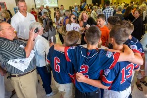 Parishioners greet Maine-Endwell Little League World Champion team members, during a reception held in their honor after Mass at Holy Family Church.