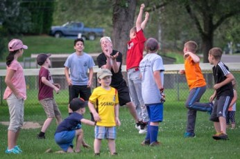Kids have fun catching water balloons in-between innings during the Men In Black softball game in Endicott on Sunday.