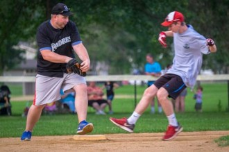 Seminarian Nathan Brooks, left and Kyle Koprevich race to second during Men In Black softball game in Endicott on Sunday. The priests and seminarians won, 15 to 8, against the parishoners of OLGC and St. Ambrose. Kyle made it to home after an error.